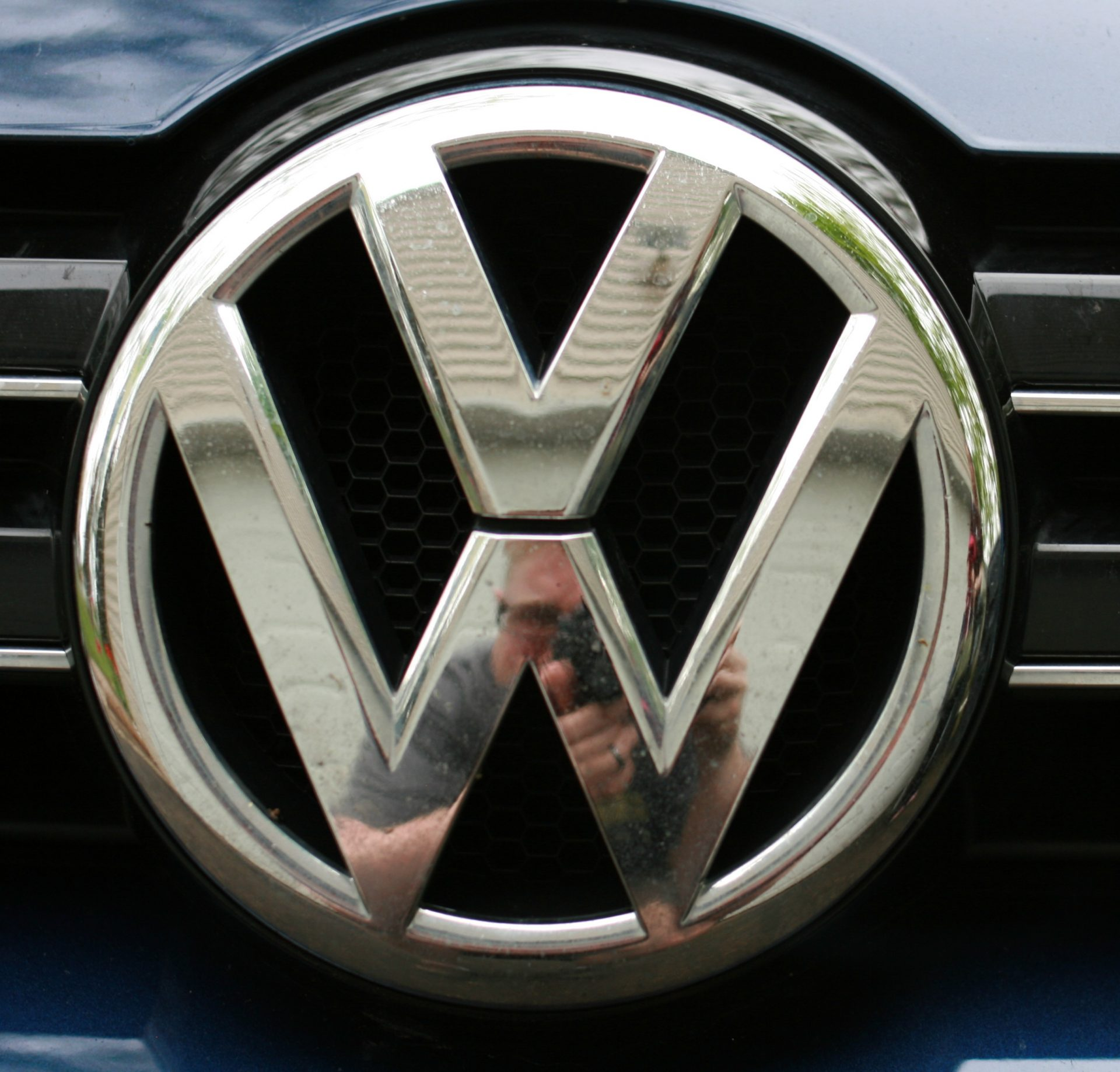 Photo of VW grill logo.