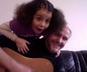 Photo of a father and daughter singing about joy.